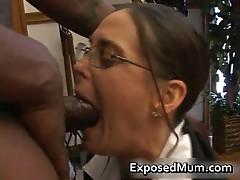 Hot Milf in glasses deepthroating black dick