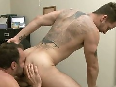 Tattooed hunk gets deep anal fuck