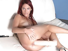 LaTina fucking her twat with a huge marital-device