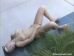 Alison Angel plays on a public bench
