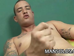 Tattooed gay stud takes out his cock to jerk