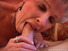 Horny granny sucking a big hard cock