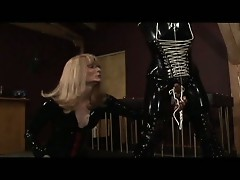 Blonde shemale tortures a horny dude in latex