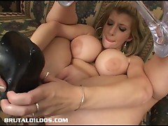 Busty brunette masturbating with a big black dildo