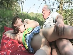 Young brunette gets hammered by old cock outdoors