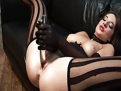 Two ladies in stockings have fun with their toys