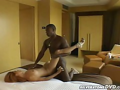 Monster black cock sizzles hard while drilling red haired bitch