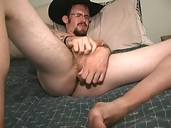 Cowboy gay lays on bed jacking off