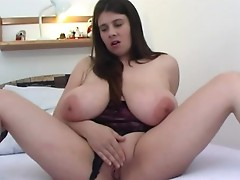 Hottie with biggest jugs masturbates