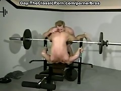 Hot gay stud and his horny friend are fucking hard in the gym