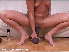 Brunette sandy summers fucking a massive dildo