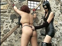 Slave gets tied up and ass spanked by this lady wearing leather