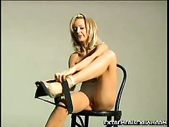 Hot blonde models a spanking hot strapon
