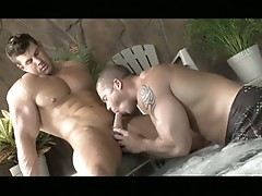 Two hot and horny muscled men sucking cock by the jacuzzi
