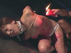 Asian slut loves burning candles with her legs