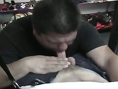 Fat dude lays on his back while his friend suck his small cock