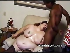 Big fat gal is trying her best to suck and fuck black cock