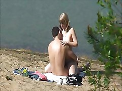 Amateur sex on the beach is being filmed by a peeper when they fuck