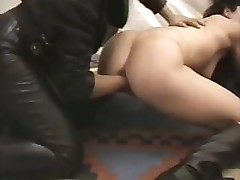 Brunettes are using a very large dildo on each other's pussy