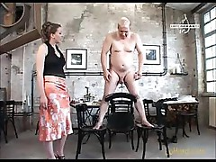 Dude is tied up and his Mistress is putting him through her paces