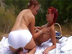 Two lesbians outside invite a cock over to make it more fun