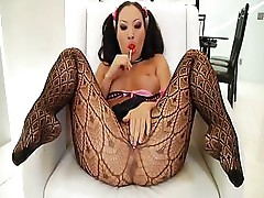 Asa Akira keeps her stocking on while playing with pussy and fucking