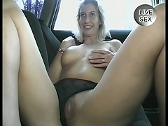 Amateur blonde masturbates in car