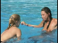 Two gorgeous hot babes making fun at the pool