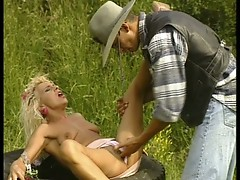 Blonde MILF fucks strapping cowboy in the grass!