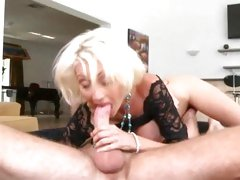 Raunchy milf spreads her moist lips round a thick boner