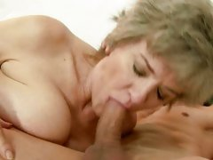 Raunchy granny spreads her lips round a stiff fuck pole