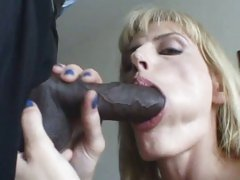 Saucy Darryl Hanah gobbles down a huge black fuck shaft