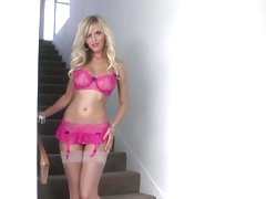 Scorching blonde models her sexy pink lingerie