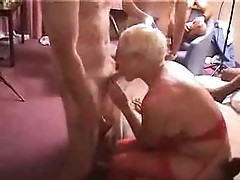 Mature girl doing interracial threesome