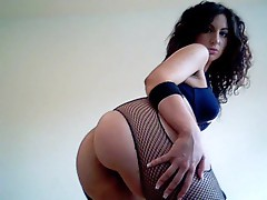 Girl in fishnets dancing lustily