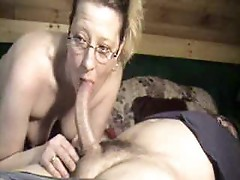 Cute wife in glasses deepthroating dick