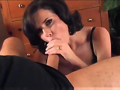 On her knees working meat with hands and mouth