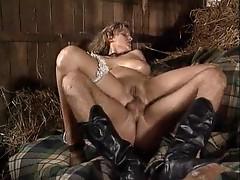 Two cocks fuck a slut in the barn