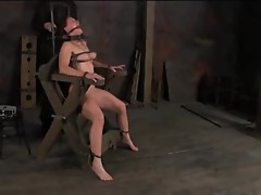 Bondage devices keep this girl restrained