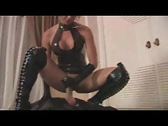 Super hot latex mistress giving handjob