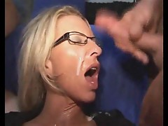 Milf in glasses is soaked in cum