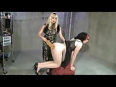 Mistress paddles the sissy in a dress