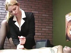 Girl in business suit gives him handjob