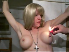Hot wax dripped on her amateur tits