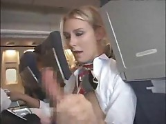 Stewardess giving customer a blowjob and handy