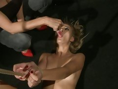 Mandy Bright force a tied babe to suck the vibrator