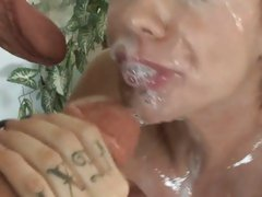 Slutty Mason Moore receives a coating of hot goo on her mouth