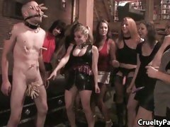 Humiliated sex slave gets his family jewels pegged by a group of sado bitches