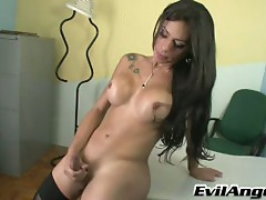Busty brunette shemale in solo action