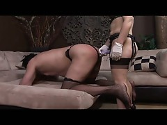 Redhead mistress gemini spanks and strapon fucks her slave